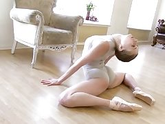 Gymnastic youthfull shorthaired babe shows abilities